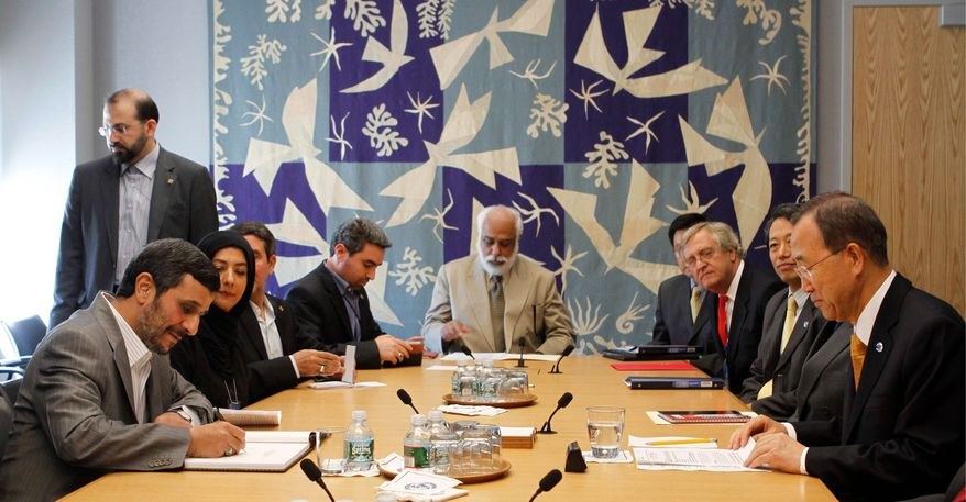 Associated Press Iranian President Mahmoud Ahmadinejad (left) confers with others at the United Nations on Sunday.