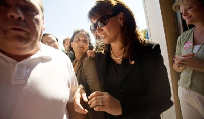 ASSOCIATED PRESS Christine O'Donnell, Delaware's Republican candidate for U.S. Senate, attends the Sussex County Republican Committee picnic at Dave Wilson's Auction on Sunday in Lincoln. She said she canceled Sunday TV talk-show appearances to campaign at events in her state.