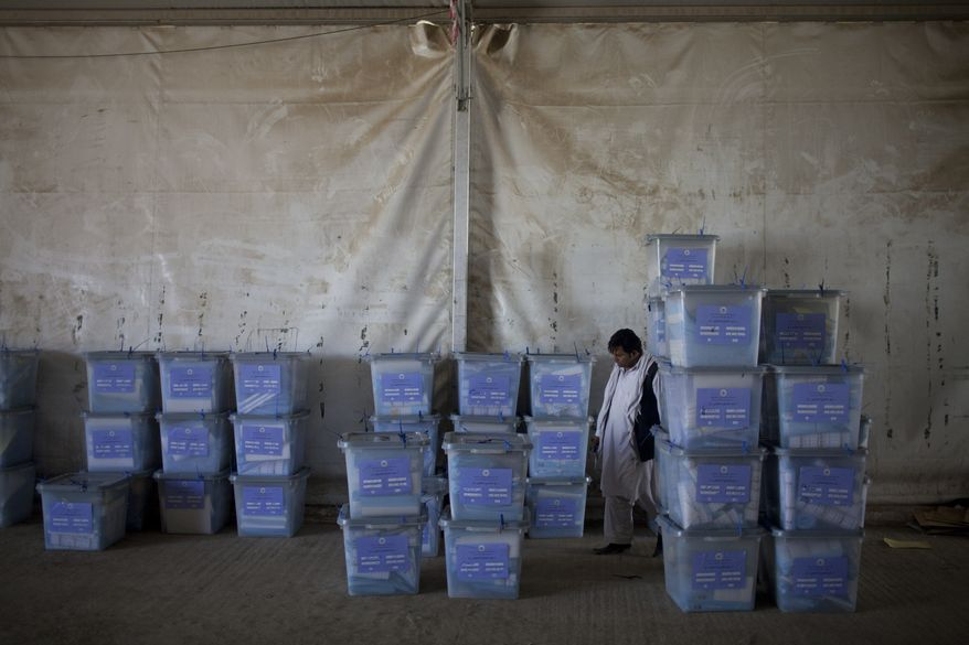 An Afghan election worker checks ballot boxes at the Independent Election Commission in Kabul, Afghanistan, on Sunday, Sept. 19, 2010. Election observers said they had serious concerns about the legitimacy of Saturday's parliamentary balloting as officials began Sunday to tally the results, a process that could take months. (AP Photo/David Guttenfelder)