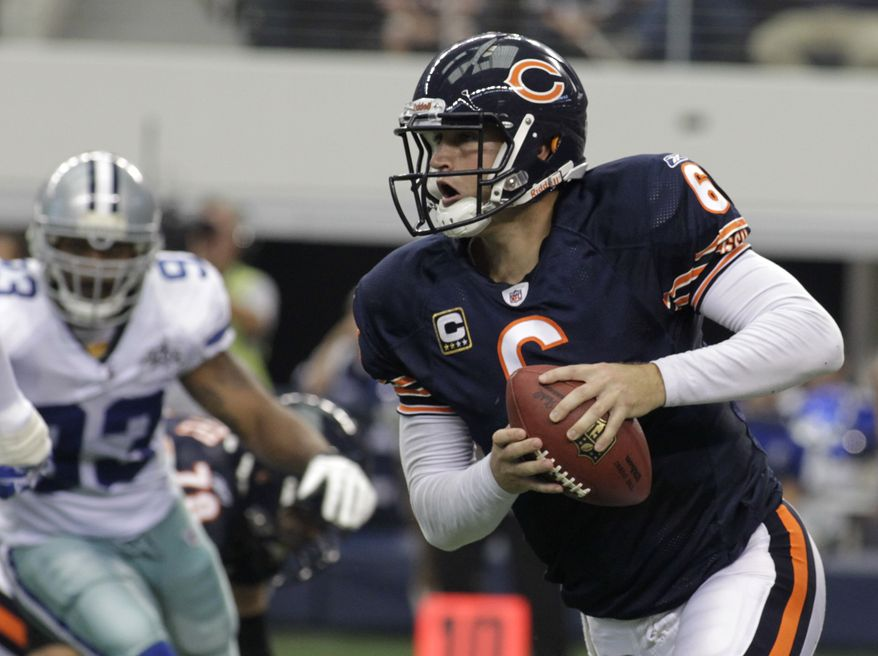 ASSOCIATED PRESS Chicago Bears quarterback Jay Cutler (6) scrambles out of the pocket as Dallas Cowboys linebacker Anthony Spencer (93) pressures in the first half of an NFL football game, Sunday, Sept. 19, 2010, in Arlington, Texas.
