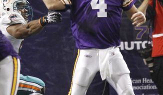 ASSOCIATED PRESS Minnesota Vikings quarterback Brett Favre (4) has the ball knocked loose as he fumbles during the second half of an NFL football game Sunday, Sept. 19, 2010, in Minneapolis. The Miami Dolphins recovered in the end zone for a touchdown.