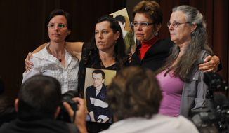 Appearing at a news conference in New York on Sunday, Sept. 19, 2010, are (from left) Sarah Shourd; Cindy Hickey, mother of Shane Bauer; Laura Fattal, mother of Josh Fattal; and Nora Shourd, Ms. Shourd's mother. Ms. Shourd was held in Iran for more than 13 months after she, Mr. Bauer and Mr. Fattal were arrested near the Iraq-Iran border for spying. (AP Photo/Stephen Chernin)