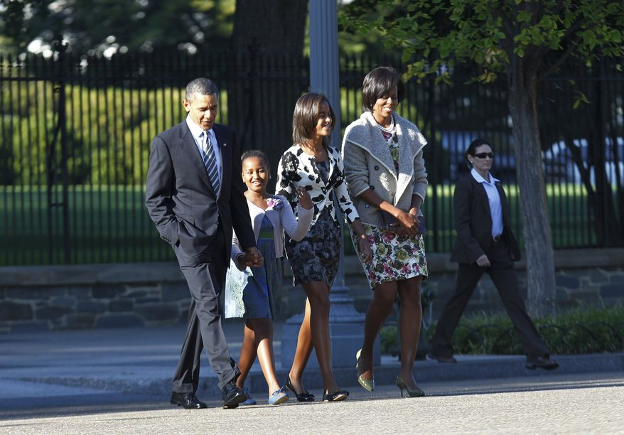 President Obama, first lady Michelle Obama (right) and their daughters, Sasha (second from left) and Malia, walk from the White House across Pennsylvania Avenue Northwest to services at St. John's Church, Lafayette Square, in Washington on Sunday, Sept. 19, 2010. (AP Photo/Charles Dharapak)