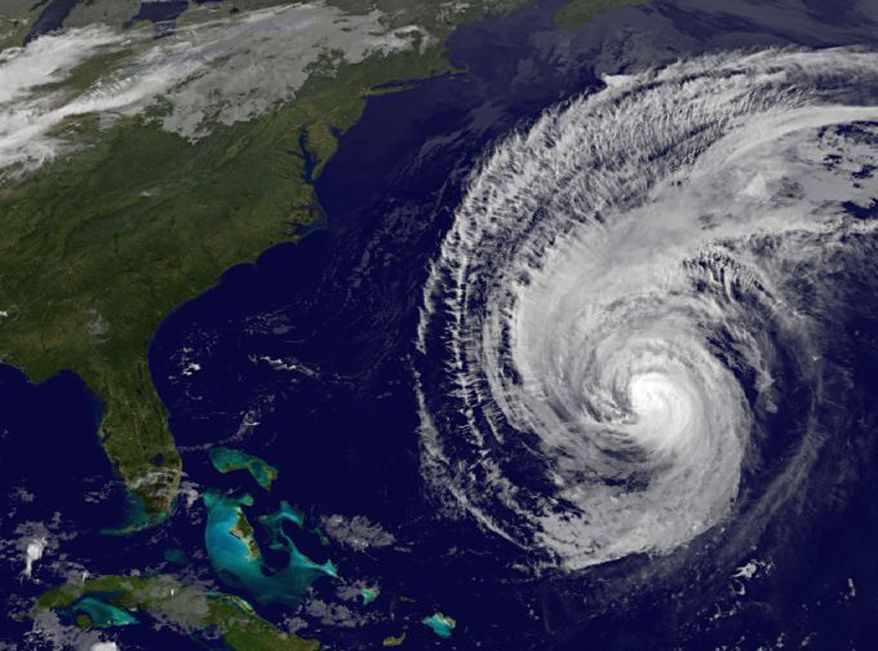 A National Oceanic and Atmospheric Administration satellite image taken on Sunday, Sept. 19, 2010, at 4:45 a.m. EDT shows a swirl of clouds in the Atlantic Ocean associated with Hurricane Igor as it moves toward Bermuda as a Category 1 storm. (AP Photo/NOAA)