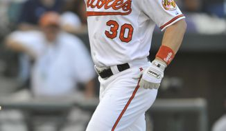 ASSOCIATED PRESS Baltimore Orioles Luke Scott reacts after hitting a solo home run against the New York Yankees to tie in the ninth inning of a baseball game Sunday, Sept. 19, 2010 in Baltimore.