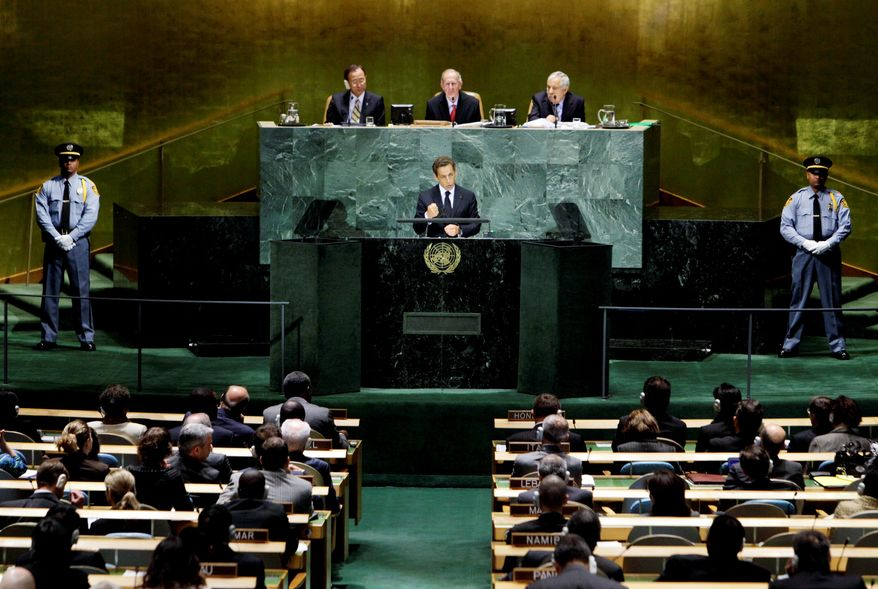 """French President Nicolas Sarkozy addresses a summit on the Millennium Development Goals at United Nations headquarters on Monday. """"The financial crisis is severe in the rich countries, it creates deficits,"""" he said, """"but its consequences are far worse for the poor countries."""" (Associated Press)"""