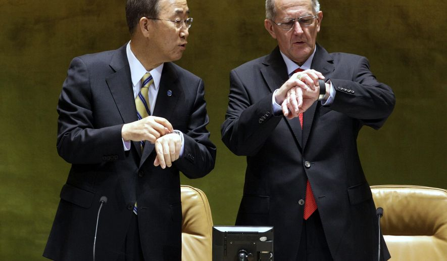U.N. Secretary-General Ban Ki-moon (left) and Joseph Deiss, president of the U.N. General Assembly, compare time at the summit on the Millennium Development Goals at the United Nations headquarters in New York on  Monday, Sept. 20, 2010. (AP Photo/Richard Drew)