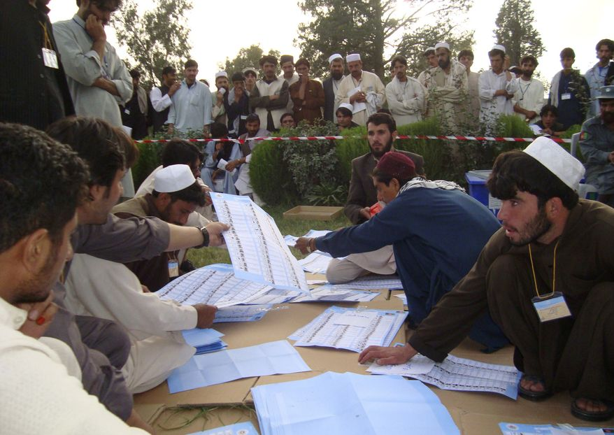Election workers count votes at the regional counting center in Khost, Afghanistan, Monday, Sept. 20, 2010. Afghan election observers urged President Hamid Karzai's government on Monday to allow an independent investigation into reports of widespread fraud during weekend's parliamentary elections, including intimidation of voters and interference by powerful warlords. (AP Photo/Nishanuddin Khan)