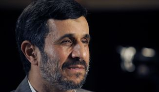 Iranian President Mahmoud Ahmadinejad is interviewed by journalists from the Associated Press on Sunday, Sept. 19, 2010, in New York. (AP Photo/Henny Ray Abrams)