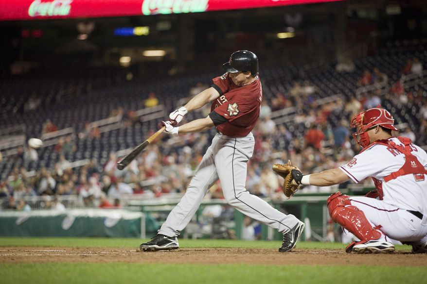 ASSOCIATED PRESS Houston Astros  Brian Bogusevic (19) hits a double during the third inning of a baseball game against the Washington Nationals on Monday, Sept. 20, 2010 in Washington. At right is Washington Nationals catcher Wilson Ramos.