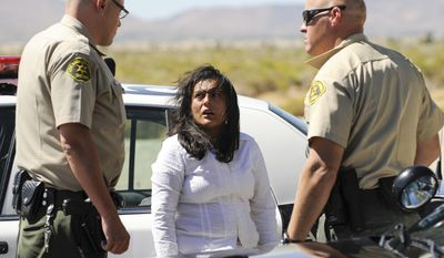Reyna Chicas, the leader of a breakaway religious sect, is taken in for questioning after her group was located by Los Angeles County Sheriffs officers at Jackie Robinson Park, outside Palmdale in Littlerock, Calif., Sunday, Sept. 19, 2010. (AP Photo/Gus Ruelas)