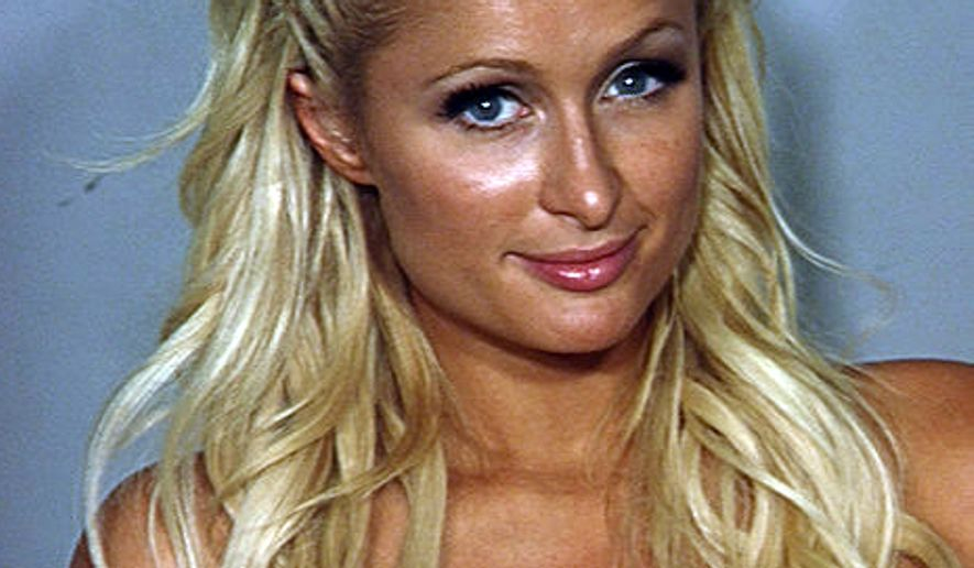 This file photo released Saturday, Aug. 28, 2010,by the Las Vegas Metropolitan Police Department shows Paris Hilton in a police booking photo in Las Vegas. (AP Photo/Las Vegas Metropolitan Police Department)