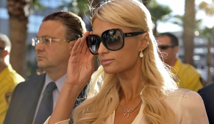 Socialite Paris Hilton and her attorney David Z. Chesnoff, left, leave the Clark County Regional Justice Center in Las Vegas, Nev. on Monday, Sept. 20, 2010. Miss Hilton pleaded guilty to two misdemeanor charges stemming from her arrest last month at a Las Vegas hotel-casino. She will serve a year of probation and avoid a felony charge under the terms of a plea deal worked out with prosecutors. (AP Photo/Mark Damon)