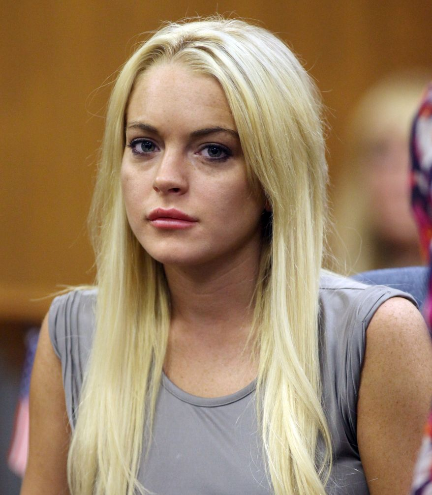 In this July 20, 2010, file photo, Lindsay Lohan is shown in court in Beverly Hills, Calif., where she was taken into custody to serve a jail sentence for probation violation. (AP Photo/Al Seib, file)