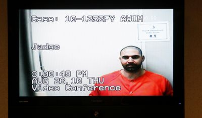 ** FILE ** Elias Abuelazam is shown on a monitor during his video arraignment at 68th District Court in Flint, Mich., on Thursday, Aug. 26, 2010. (AP Photo/Paul Sancya)