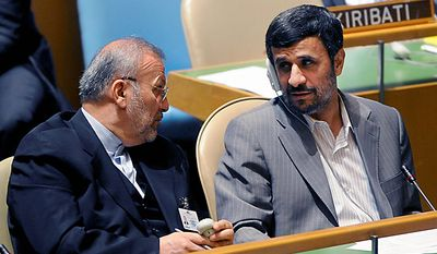 Iranian President Mahmoud Ahmadinejad, right, talks with Iranian Foreign Minster Manouchehr Mottaki during the summit on the Millennium Development Goals at United Nations headquarters on Sept. 20, 2010. (AP Photo/Henny Ray Abrams)