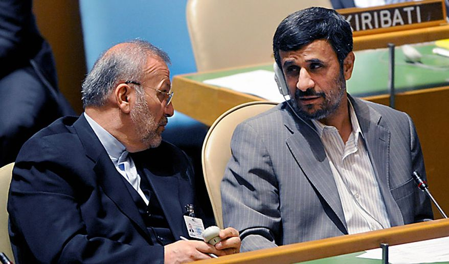 Iranian President Mahmoud Ahmadinejad, right, talks with Iranian Foreign Minster Manouchehr Mottaki during the summit on the Millennium Development Goals at United Nations headquarters on Sept. 20, 2010. (AP Photo/Henny Ray Abrams)