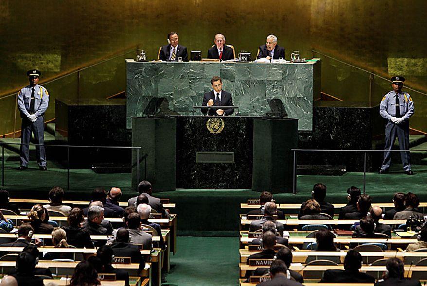 Nicolas Sarkozy, President of France, addresses a summit on the Millennium Development Goals at United Nations headquarters on Monday, Sept. 20, 2010. (AP Photo/Richard Drew)