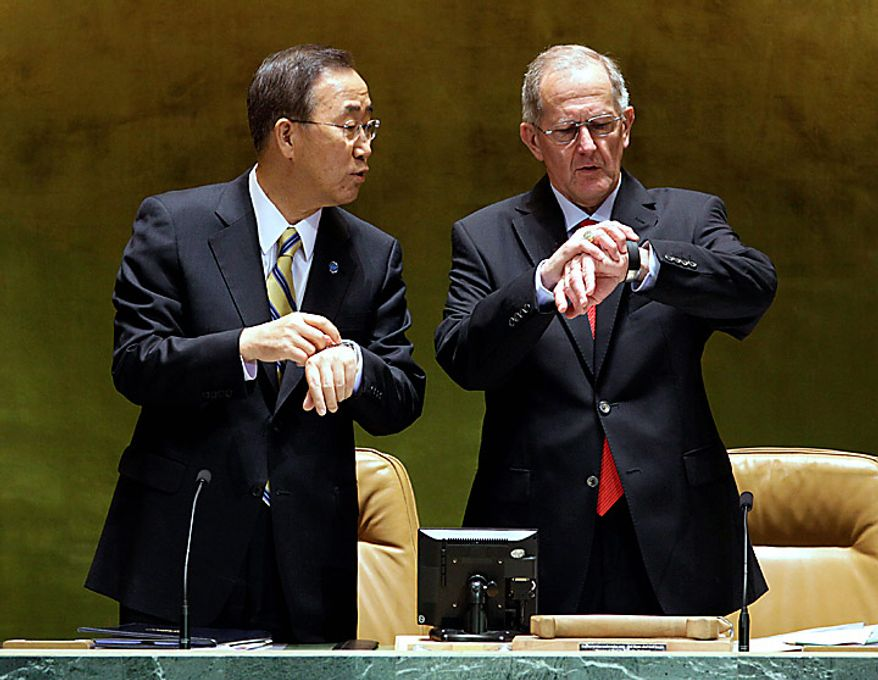 UN Secretary-General Ban Ki-moon, left, and Joseph Deiss, of Switzerland and President of the UN General Assembly, compare their watches at the summit on the Millennium Development Goals at United Nations headquarters,  Monday, Sept. 20, 2010. (AP Photo/Richard Drew)