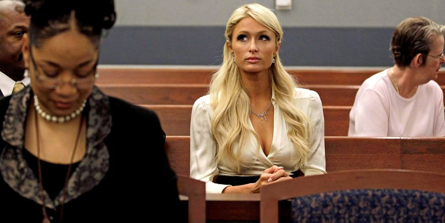 Paris Hilton waits for her hearing to start in Clark county court to plead guilty to reduced charges in her August cocaine arrest Monday, Sept. 20, 2010, in Las Vegas. Under the terms of a plea deal worked out with prosecutors, the heiress will serve a year of probation and avoid a felony conviction. (AP Photo/Julie Jacobson)