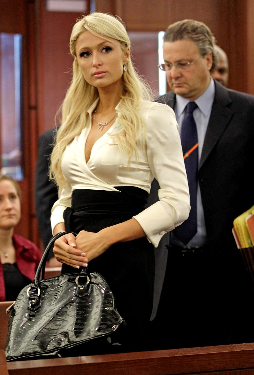 Paris Hilton arrives in county court with her attorney David Chesnoff  to plead guilty to reduced charges in her Las Vegas cocaine arrest Monday, Sept. 20, 2010, in Las Vegas. Under the terms of a plea deal worked out with prosecutors, the heiress will serve a year of probation and avoid a felony conviction. (AP Photo/Julie Jacobson)