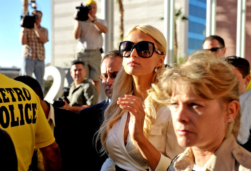 Socialite Paris Hilton leaves the Clark County Regional Justice Center in Las Vegas, Nev. on Monday, Sept. 20, 2010. Hilton pleaded guilty to two misdemeanor charges stemming from her arrest last month at a Las Vegas hotel-casino. She will serve a year of probation and avoid a felony charge under the terms of a plea deal worked out with prosecutors. (AP Photo/Mark Damon)