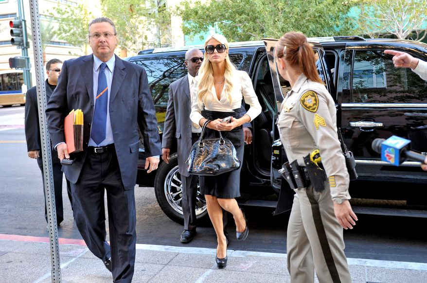 Socialite Paris Hilton arrives with her attorney David Z. Chesnoff, left, at the Clark County Regional Justice Center in Las Vegas, Nev. on Monday, Sept. 20, 2010. Hilton pleaded guilty to two misdemeanor charges stemming from her arrest last month at a Las Vegas hotel-casino. She will serve a year of probation and avoid a felony charge under the terms of a plea deal worked out with prosecutors. (AP Photo/Mark Damon)