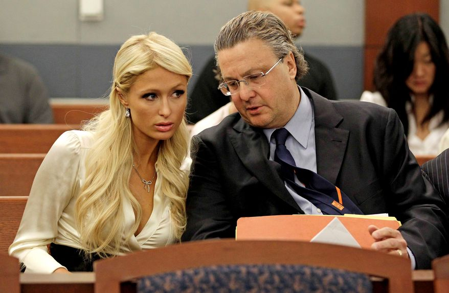 Paris Hilton, left, talks with her attorney, David Chesnoff, before her hearing in Clark County court Monday, Sept. 20, 2010, in Las Vegas. Hilton pleaded guilty to two misdemeanor charges stemming from her arrest last month at a Las Vegas hotel-casino.  She will serve a year of probation and avoid a felony charge under the terms of a plea deal worked out with prosecutors. (AP Photo/Julie Jacobson)