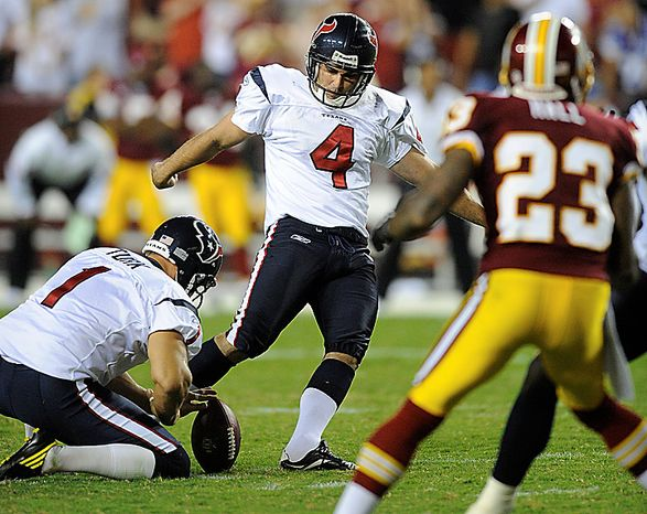 Houston Texans kicker Neil Rackers kicks the game winning field goal during the overtime in an NFL football game against the Washington Redskins in Landover, Md., on Sunday, Sept. 19, 2010.  The Houston Texans won 30-27. (AP Photo/Nick Wass)