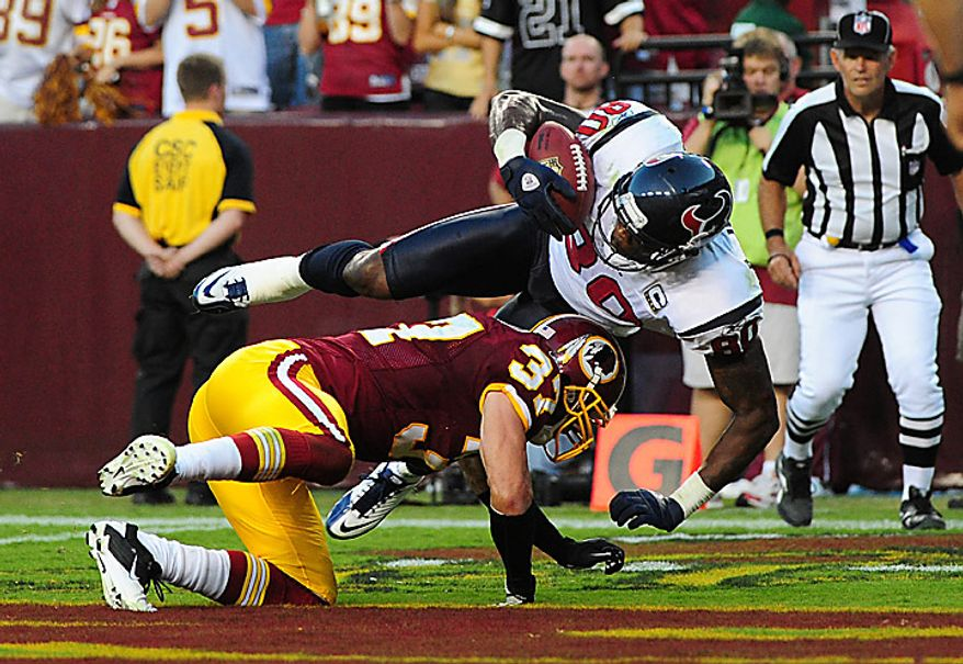 Houston Texans' Andre Johnson brings in a 34-yard touchdown reception over Washington Redskins' safety Reed Doughty at FedEx Field in Washington on September 19, 2010. The Texans defeated the Redskins 30-27.   UPI/Kevin Dietsch