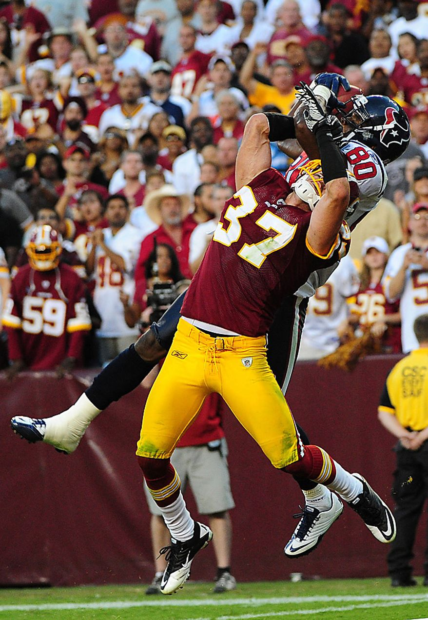 Houston Texans' Andre Johnson brings in a 34-yard game tying  touchdown reception over Washington Redskins' safety Reed Doughty at FedEx Field in Washington on September 19, 2010. The Texans defeated the Redskins 30-27.   UPI/Kevin Dietsch