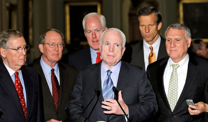 ASSOCIATED PRESS PHOTOGRAPHS Sen. John McCain (center) leads a news conference on Capitol Hill on Tuesday prior to the Senate vote on the defense authorization bill. From left: Senate Minority Leader Mitch McConnell, Sen. Lamar Alexander, Sen. John Cornyn, Sen. John Thune and Senate Minority Whip Jon Kyl.
