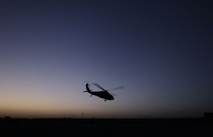 ** FILE ** A U.S. Army Black Hawk helicopter prepares to depart from a forward operating base in the Zhari district of southern Afghanistan on Sept. 11, 2010. (AP Photo/Brennan Linsley)