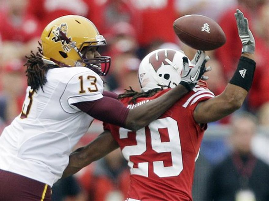 Wisconsin cornerback Niles Brinkley (29) breaks up a pass intended for Arizona State wide receiver George Bell (13) during the second half of an NCAA college football game Saturday, Sept. 18, 2010, in Madison, Wis. Wisconsin won 20-19. (AP Photo/Morry Gash)