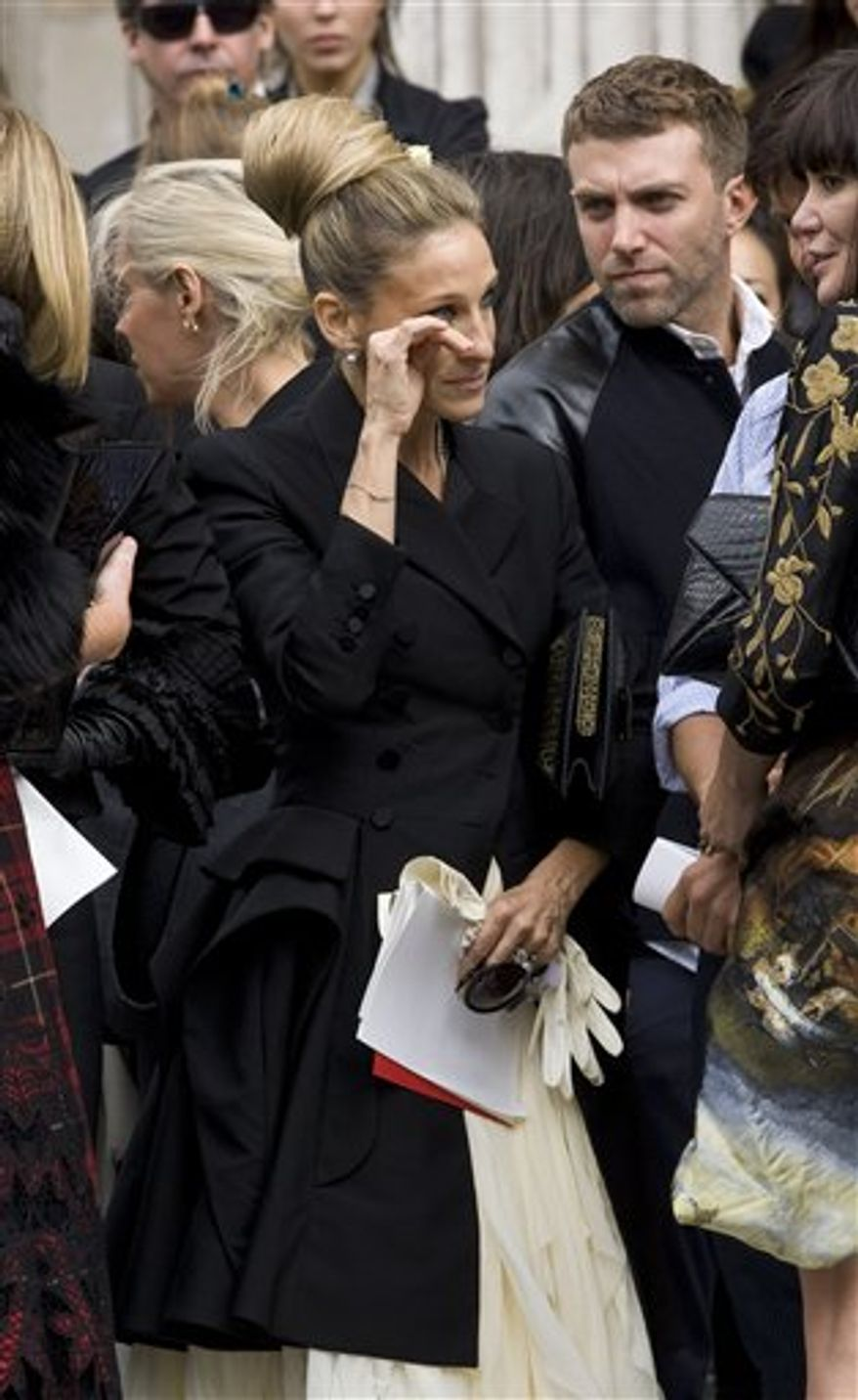 Daphne Guinness trips on the cobbled streets as she arrives to attend the Alexander McQueen memorial service at St Paul's Cathedral in London Monday, Sept. 20, 2010, which takes place during London Fashion Week. (AP Photo/Joel Ryan)