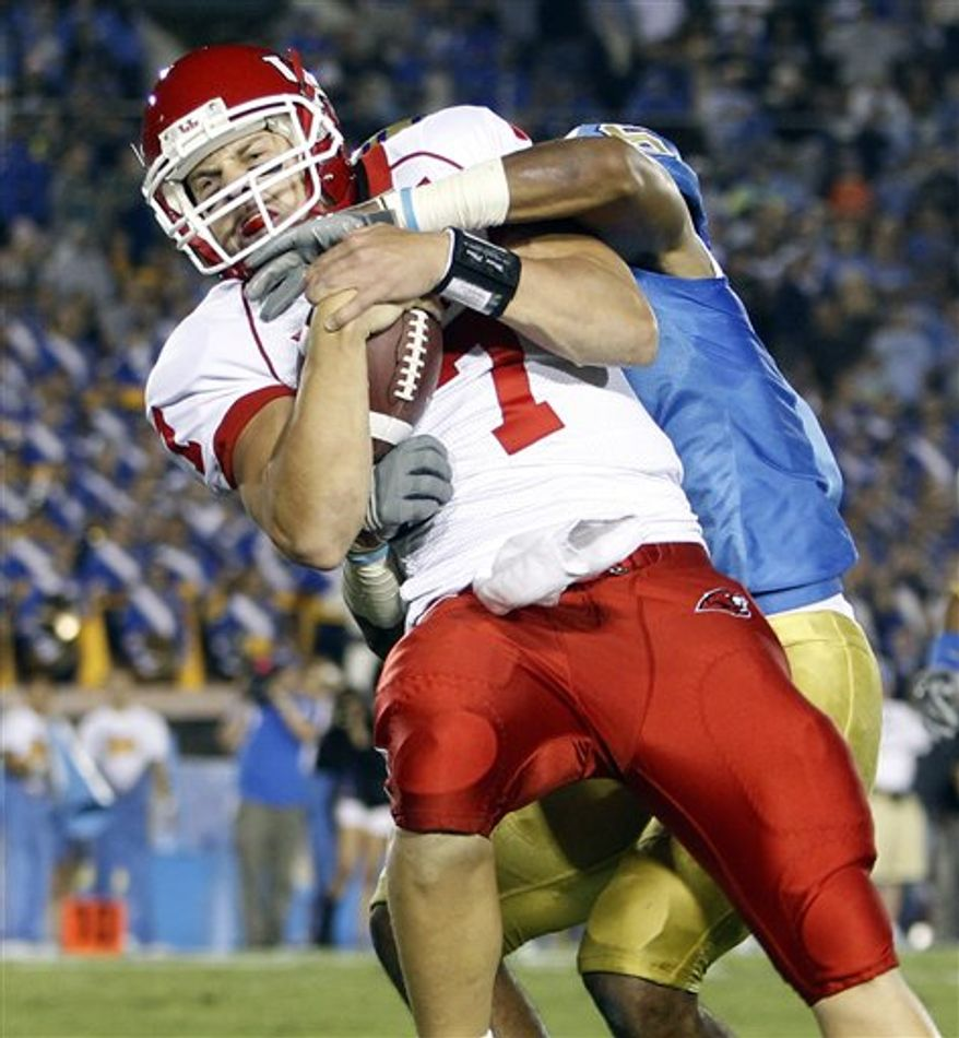 Houston quarterback Case Keenum (7) is stopped by UCLA safety Tony Dye after a 45-yard scramble in the first half of an NCAA college football game, Saturday, Sept. 18, 2010, in Pasadena, Calif. (AP Photo/Alex Gallardo)