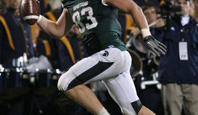 Michigan State tight end Charlie Gantt looks back to find himself alone as he scores the game-winning touchdown on a 29-yard pass reception off a fake field goal during overtime of an NCAA college football game against Notre Dame, Saturday, Sept. 18, 2010, in East Lansing, Mich. Michigan State won 34-31. (AP Photo/Al Goldis)
