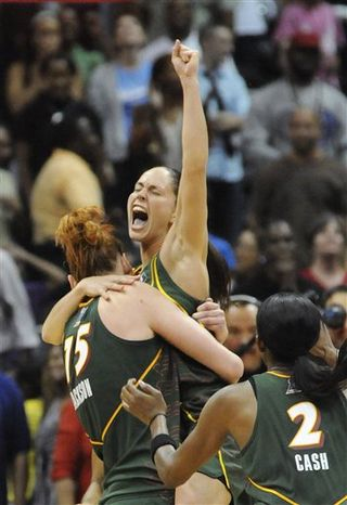 Seattle Storm guard Sue Bird, right, celebrates with Lauren Jackson, of Australia, after the Storm defeated the Atlanta Dream 87-84 in Game 3 of the WNBA basketball finals Thursday, Sept. 16, 2010, in Atlanta, sweeping the series. (AP Photo/Eric S. Lesser)
