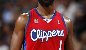 FILE - This March 14, 2009, file photo shows Los Angeles Clippers' Baron Davis smiling during a basketball game against the Denver Nuggets, in Denver.  The nomination for Davis' documentary on L.A. gang life is just part of his plan to make a difference, on and off the court. (AP Photo/David Zalubowski, File)