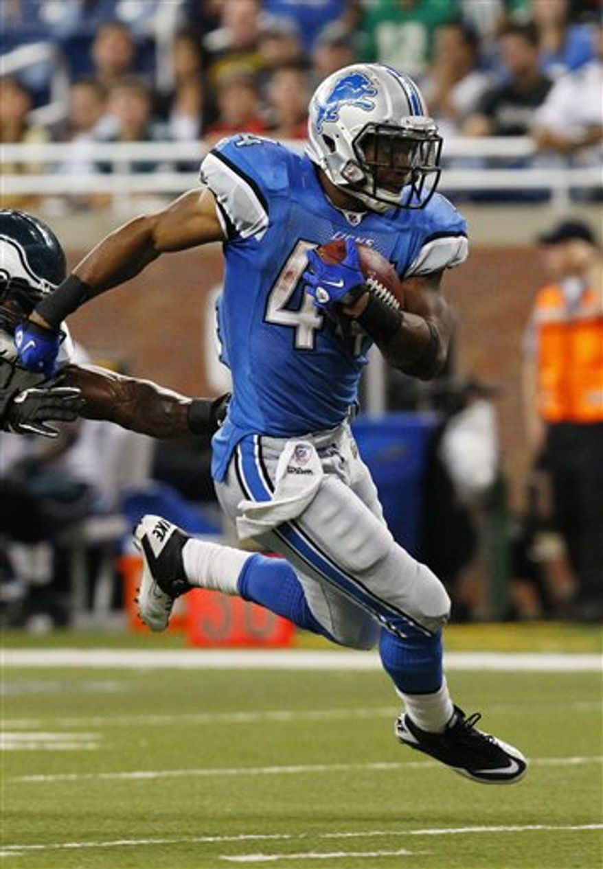 FILE - This Sept. 19, 2010, file photo shows Detroit Lions running back Jahvid Best running against the Philadelphia Eagles, in Detroit. The rookie has already scored five touchdowns in his first two games, and he had 232 yards from scrimmage in Sunday's loss to Philadelphia.  (AP Photo/Rick Osentoski, File)