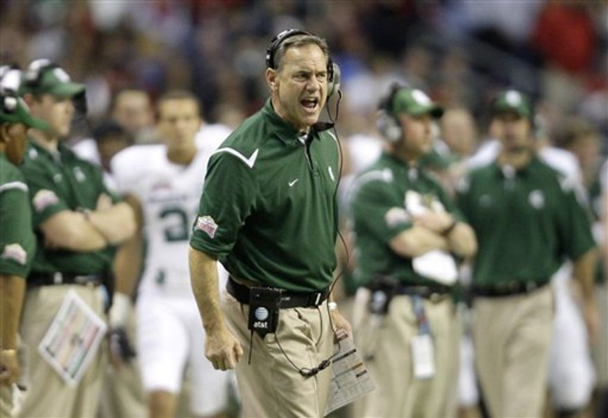 FILE- This Jan. 2, 2010 file photo shows  Michigan State coach Mark Dantonio giving instruction to his players during the third quarter of the Alamo Bowl NCAA college football game against Texas Tech in San Antonio. Dantonio was hospitalized Sunday Sept. 19, 2010, after suffering a mild heart attack shortly after an overtime victory against Notre Dame. (AP Photo/Eric Gay,File)