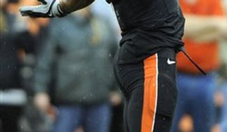 Oregon State's Jacquizz Rodgers (1) is congratulated by John Reese (80) and Joe Halahuni (87) after a touchdown against Louisville, during the first half of an NCAA college football game in Corvallis, Ore., Saturday Sept. 18, 2010. (AP Photo/Greg Wahl-Stephens)