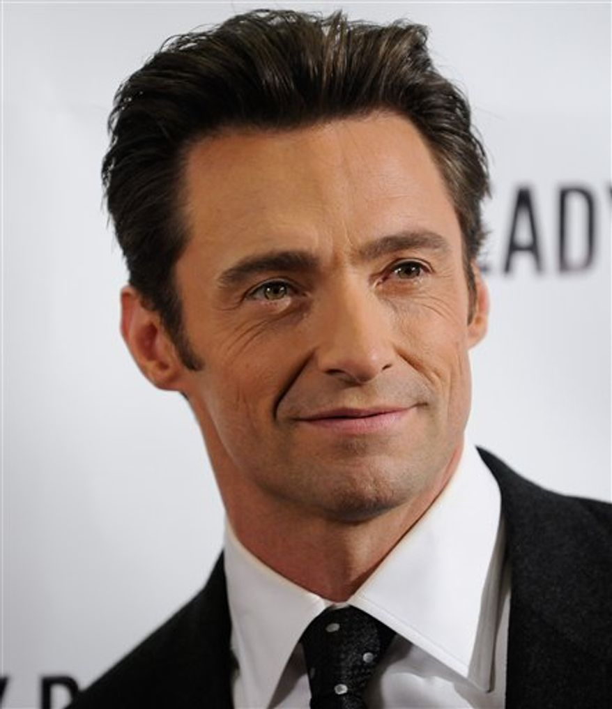 """FILE - In this Sept. 29, 2009 file photo, actor Hugh Jackman poses during a photo opportunity following the Broadway opening performance of 'A Steady Rain' in New York. Authorities say a helicopter used in the filming of the Hugh Jackman movie """"Real Steel"""" snagged a power line in Michigan, causing a brief power outage and closing a roadway. Huron County Sheriff Kelly J. Hanson tells the Huron Daily Tribune of Bad Axe that no injuries were reported after the Sunday evening accident in Huron County's Sheridan Township, about 90 miles north of Detroit. (AP Photo/Evan Agostini, File)"""