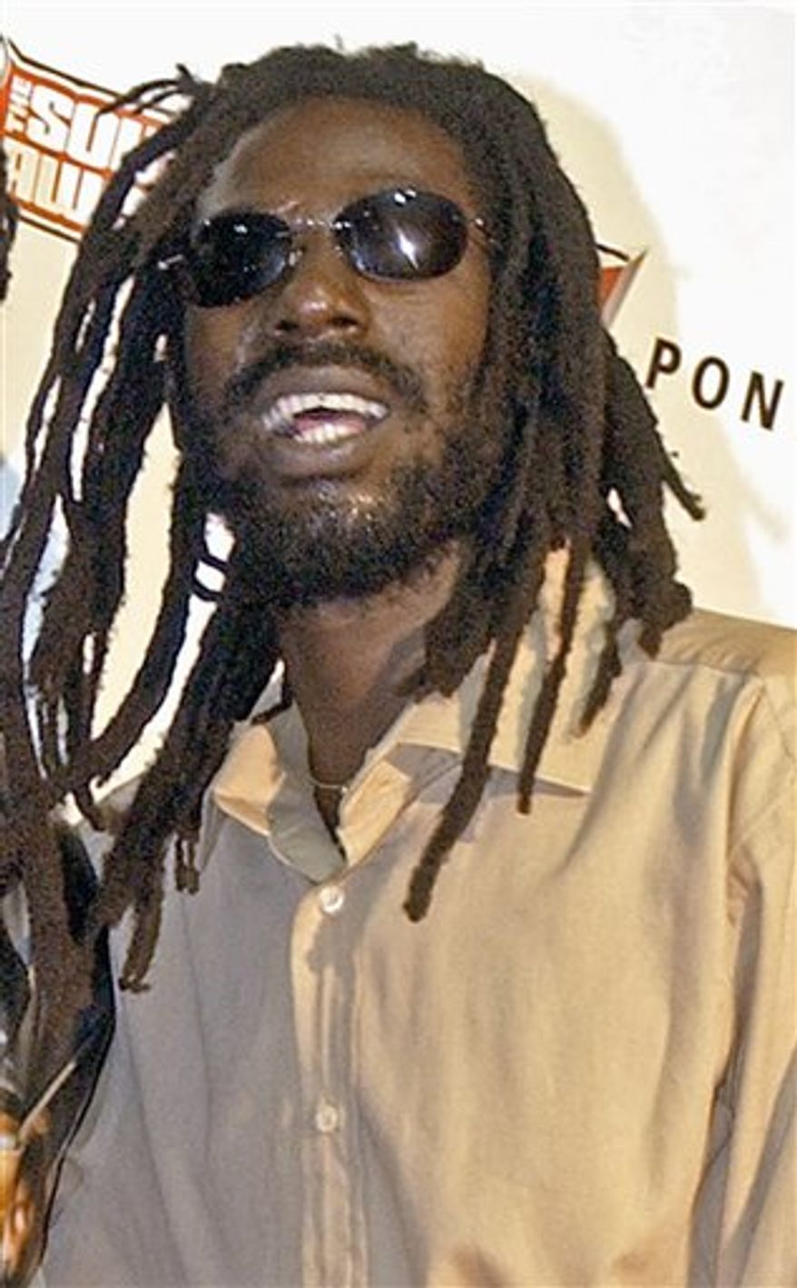 FILE - In this Oct. 13, 2003 file photo, Jamaican reggae star Buju Banton poses at the Source Hip-Hop Music Awards in Miami. A Florida jury has found Grammy-winning reggae singer Buju Banton guilty on cocaine conspiracy charges. Jurors returned their verdict on Tuesday, Feb. 22, 2011 after deliberating for 11 hours over two days. (AP Photo/Yesikka Vivancos, File)