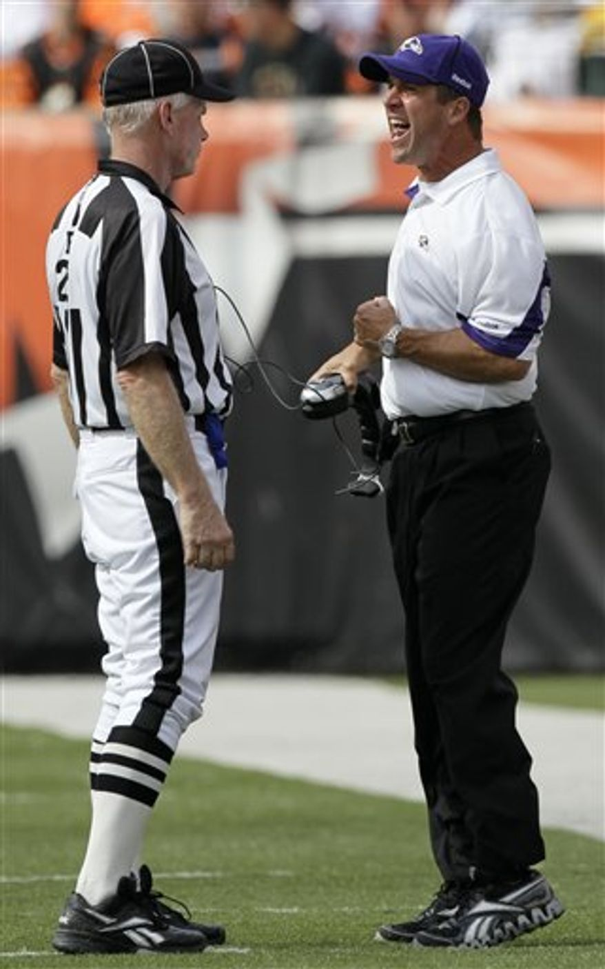 Baltimore Ravens coach John Harbaug complains to field judge Bob Waggoner during the second half of an NFL football game against the Cincinnati Bengals, Sunday, Sept. 19, 2010, in Cincinnati. (AP Photo/Ed Reinke)
