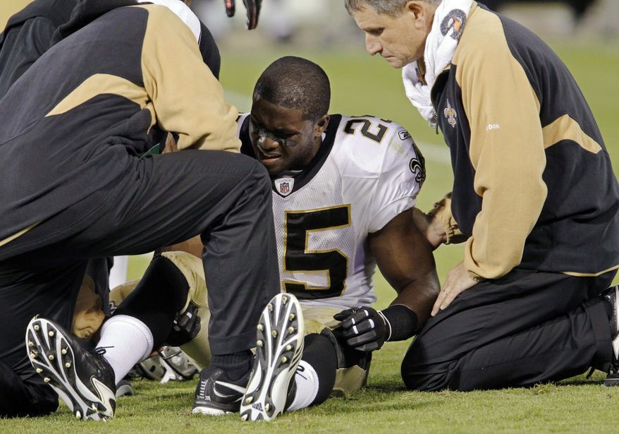 ASSOCIATED PRESS New Orleans Saints running back Reggie Bush (25) is assisted after suffering an injury in the fourth quarter against the San Francisco 49ers during an NFL football game in San Francisco, Monday, Sept. 20, 2010.