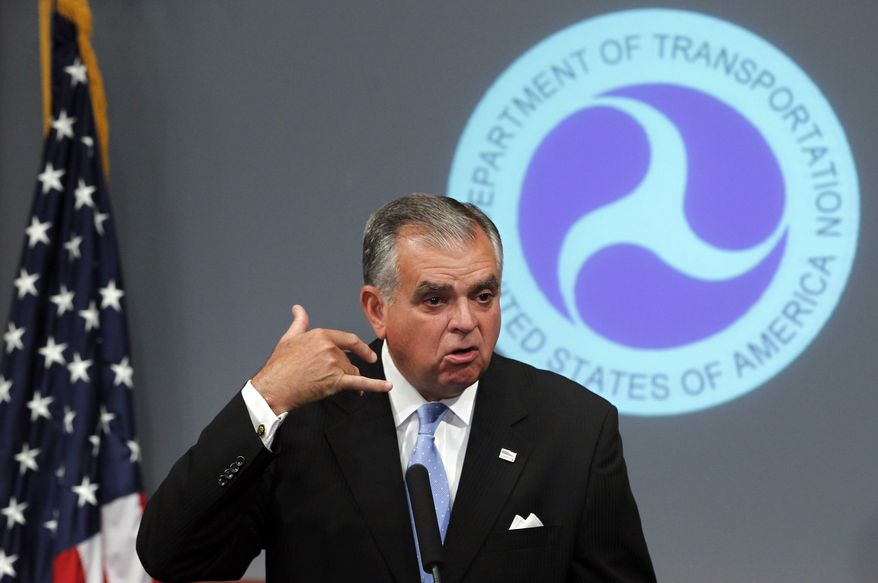 Transportation Secretary Ray LaHood mimics cell phone use as he talks about distracted driving duirng a press conference at the Department of Transportation in Washington, Thursday, Sept. 9, 2010, announcing the lowest traffic fatalities in six decades. (AP Photo/Charles Dharapak)