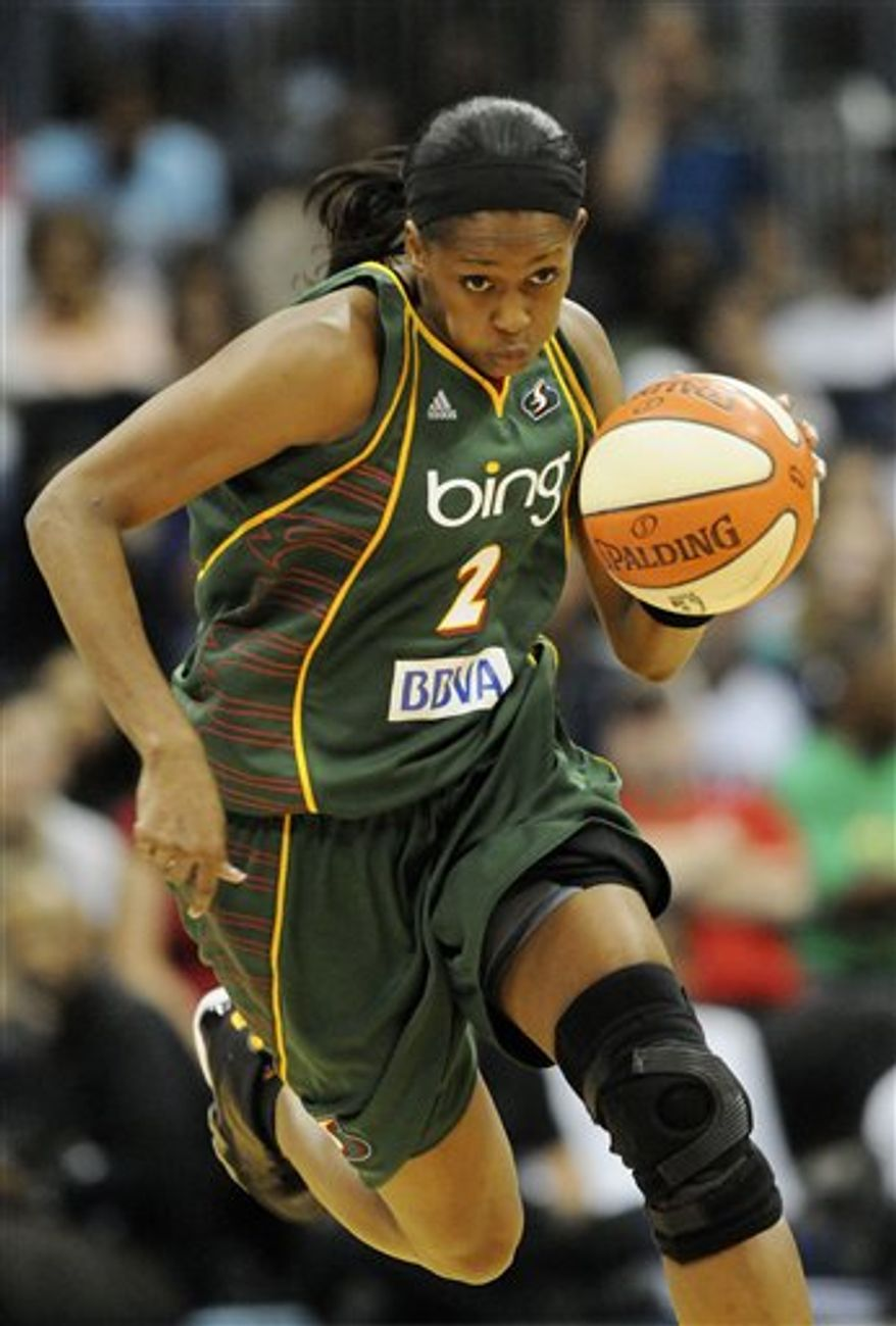Seattle Storm forward Swin Cash drives down the court during the second half of Game 3 of the WNBA Finals basketball game against the Atlanta Dream in Atlanta on Thursday, Sept. 16, 2010. Seattle won 87-84 and swept the best-of-five series 3-0. (AP Photo/Eric S. Lesser)