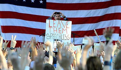 """Former Air Force Staff Sgt. David Hall, photographs the crowd for twitter at a rally where recording artist Lady Gaga spoke in support of repealing the military's """"don't ask, don't tell"""" policy for gay service members, in Portland, Maine, on Monday, Sept. 20, 2010.  (AP Photo/Pat Wellenbach)"""
