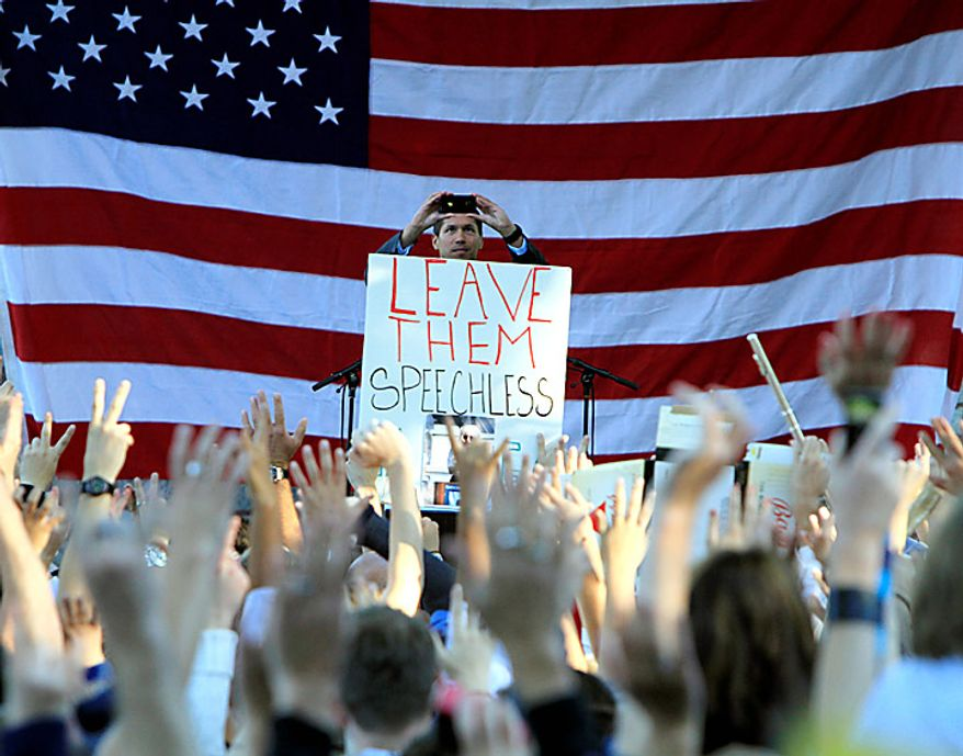 "Former Air Force Staff Sgt. David Hall, photographs the crowd for twitter at a rally where recording artist Lady Gaga spoke in support of repealing the military's ""don't ask, don't tell"" policy for gay service members, in Portland, Maine, on Monday, Sept. 20, 2010.  (AP Photo/Pat Wellenbach)"